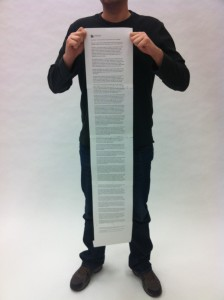 Here I am holding a print out of Madore's post in size 14 font. For reference, I stand 6 feet 2 inches tall.