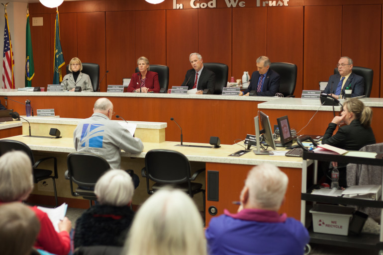 The newly expanded Clark County council held its first meeting Tuesday. Councilor Jeanne Stewart, from left, Councilor Julie Olson, Council Chairman Marc Boldt, Councilor David Madore and Councilor Tom Mielke kicked off the year with a long, contentious meeting. (Tommy Rhodes for the Columbian)