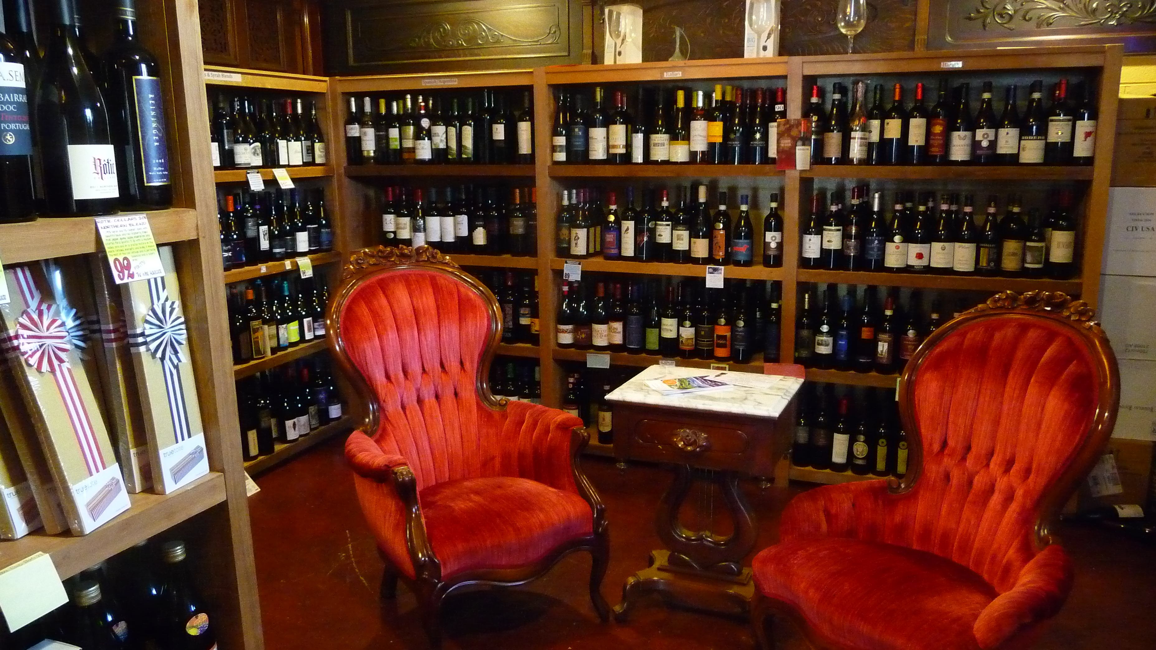 Cozy interior seating at Evergreen Wine Cellar surrounded by fine wines from around the world and & Evergreen Wine Cellaru0027s Italian tasting tonight Latte dau0027s wine bar ...