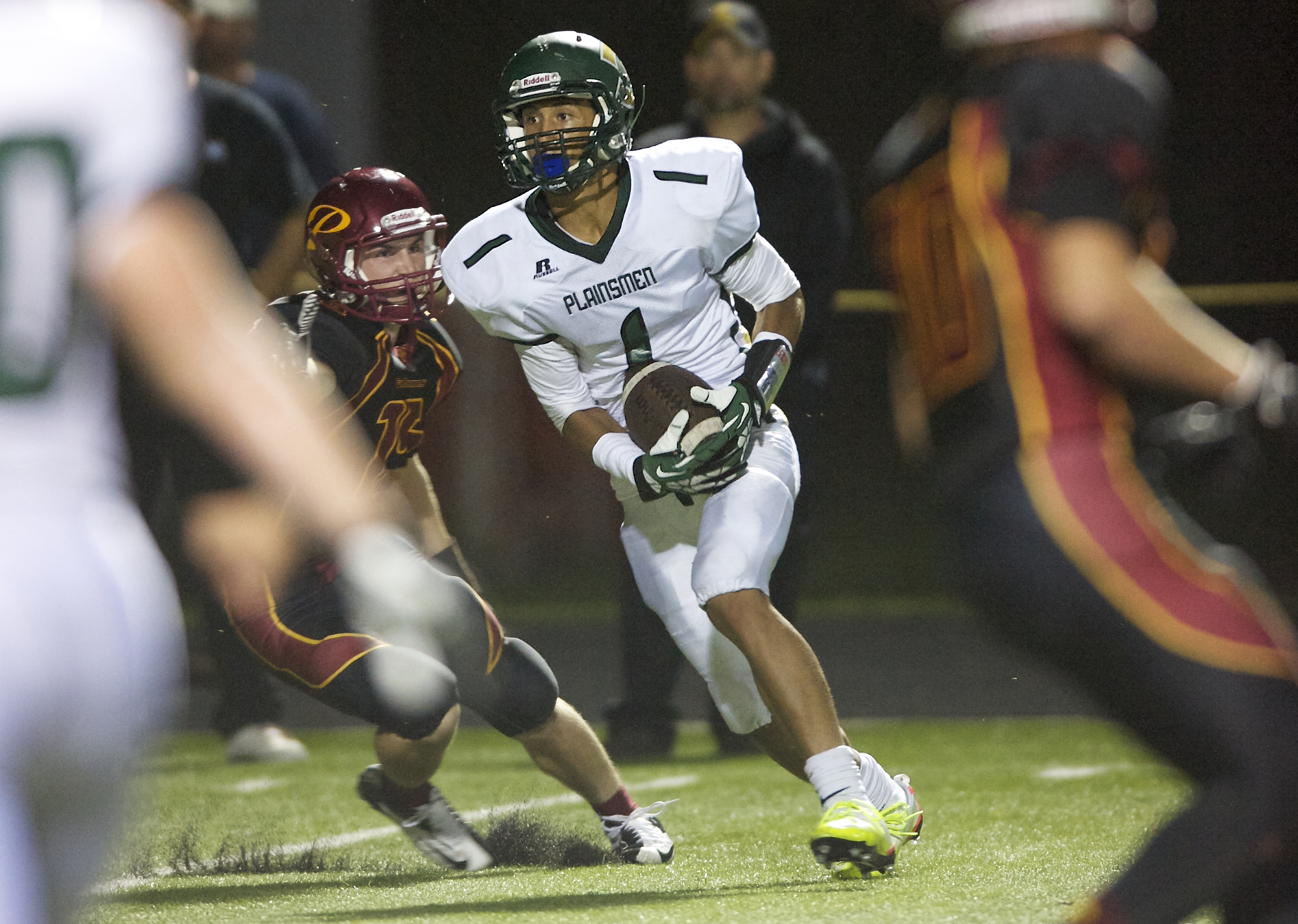 Evergreen's Justice Murphy converts a two-point conversion to put the Plainsmen up 29-20 over Prairie late in the fourth quarter at District Stadium on Friday September 20, 2013. (Zachary Kaufman/The Columbian)