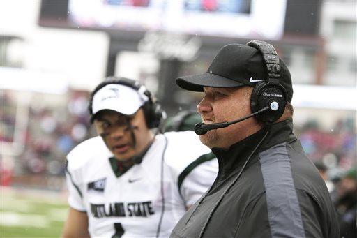 Portland State head coach Bruce Barnum, right, watches during the first half of an NCAA college football game against Washington State, Saturday, Sept. 5, 2015, in Pullman, Wash. Skyview grad Kieran McDonagh is in the background. (AP Photo/Young Kwak)
